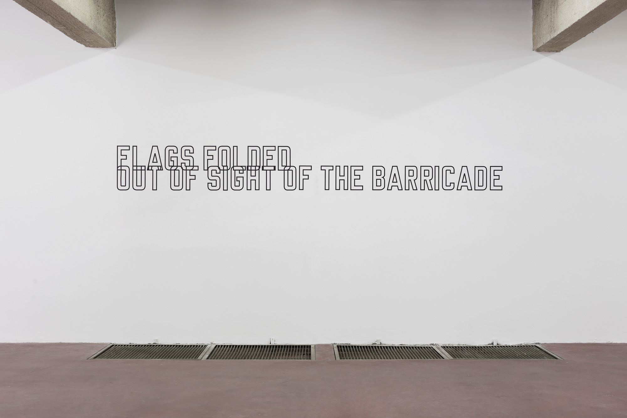Lawrence Weiner, Flags Folded out of Sight of the Barricade, 1989, vinyl text, dimensions variable, unique