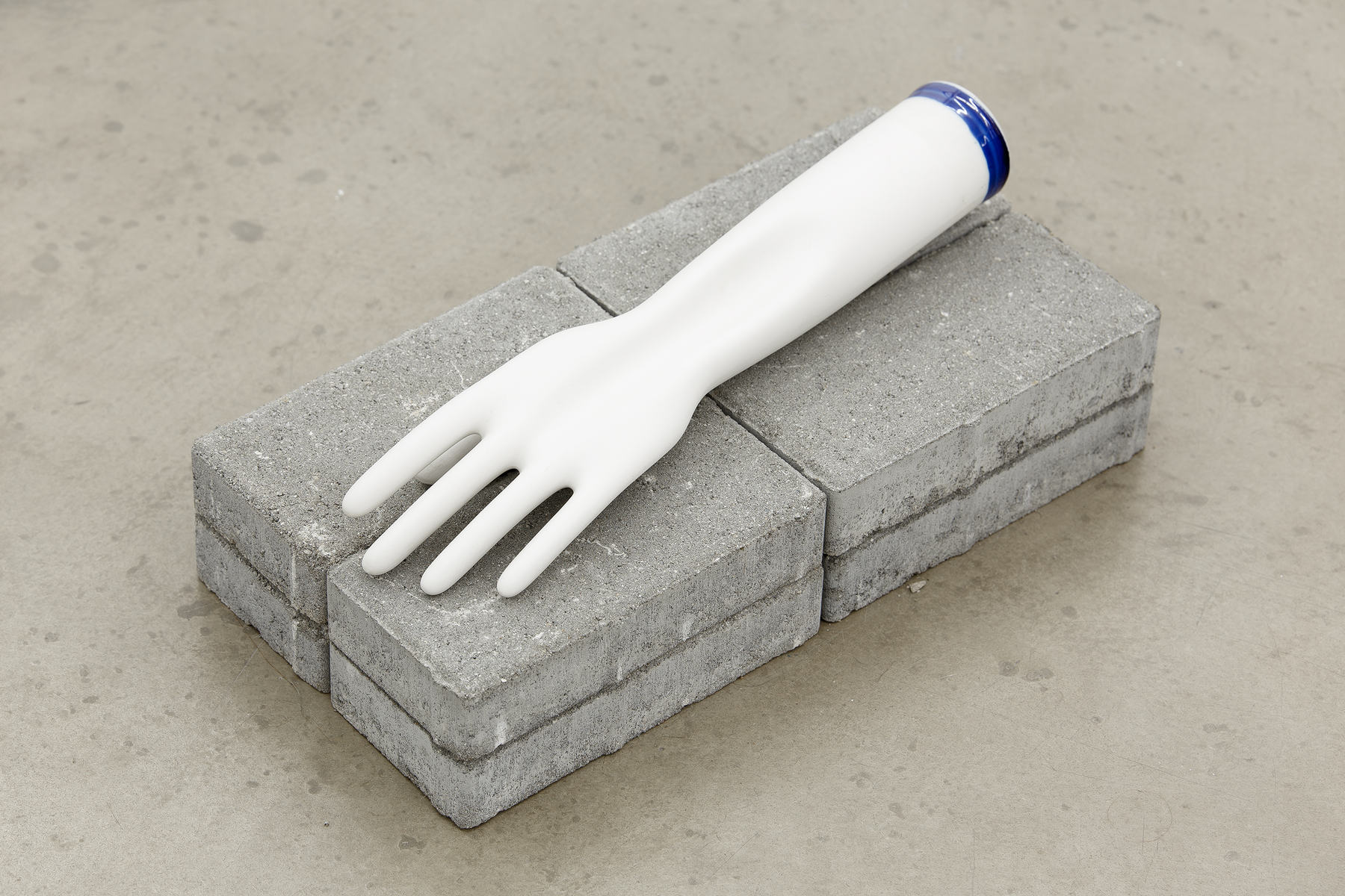 How it's made, 2015, porcelain glove mold, 9 x 27 cm