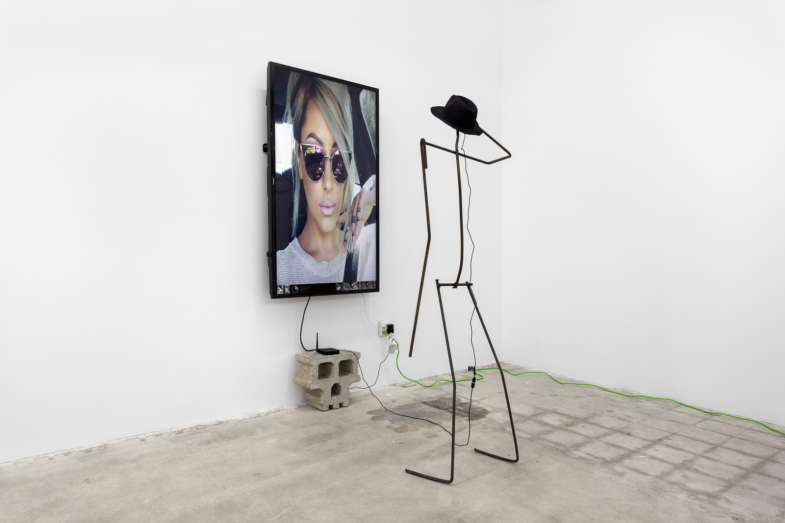 Versteeg_Permanent Vacation_Cement, welded steel, internet-connected computer program with output to 65 inch LCD screen, web cam, straw hat_2016