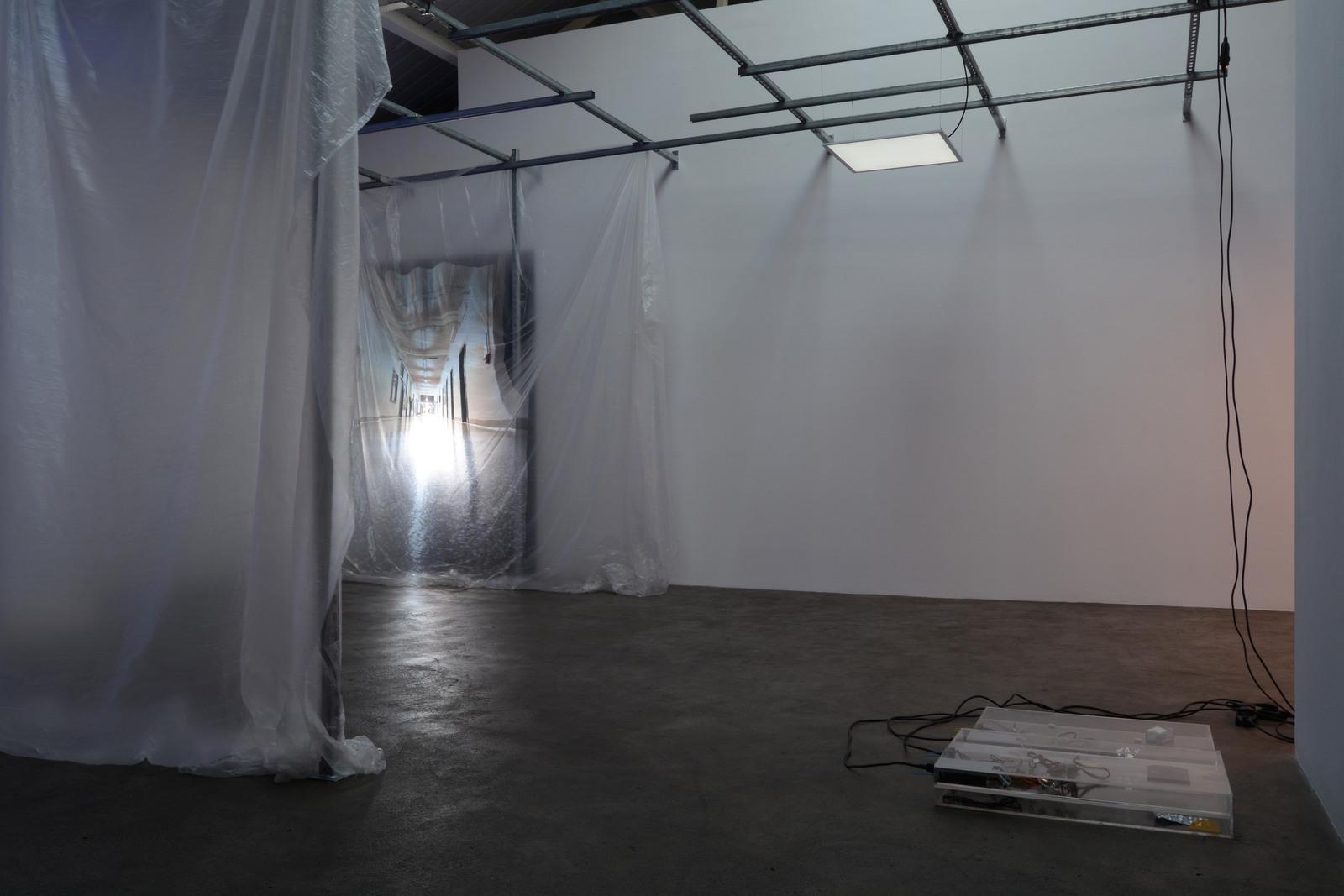2. Yuri Pattison_sunset provision_installation view_(infinite corridor, infinite) Sunset Provision_dust,scraper, fan